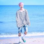 Jimin at the Beach wearing his striped Shirt