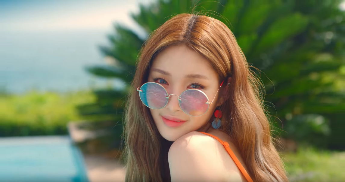 Chung Ha wearing rosy sunglasses in her MV Love U
