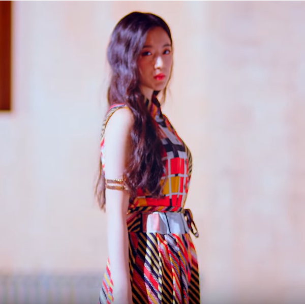 GIDLE Shuhua wearing a striped dress in the MV for Hann
