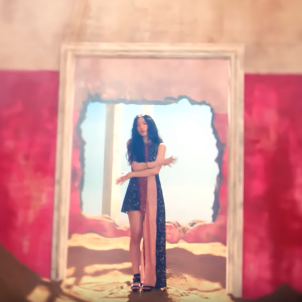 GIDLE Shuhua wearing a flower dress in the MV for HANN